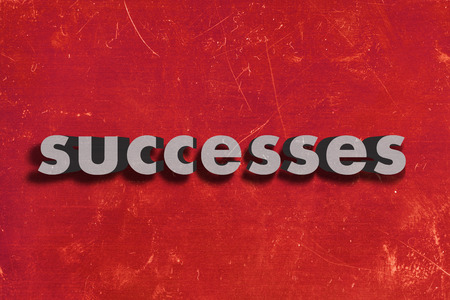 successes: gray word on red wall