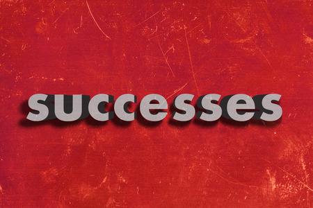 successes: grigio parola su muro rosso