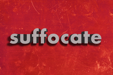suffocate: gray word on red wall