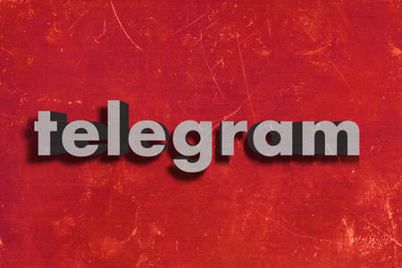 telegram: gray word on red wall