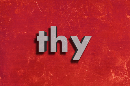 thy: gray word on red wall