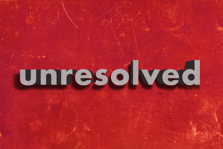 unresolved: gray word on red wall