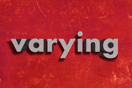 varying: gray word on red wall