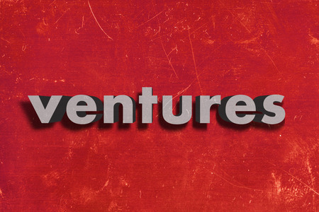 ventures: gray word on red wall
