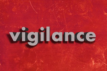vigilance: gray word on red wall
