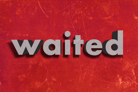waited: gray word on red wall