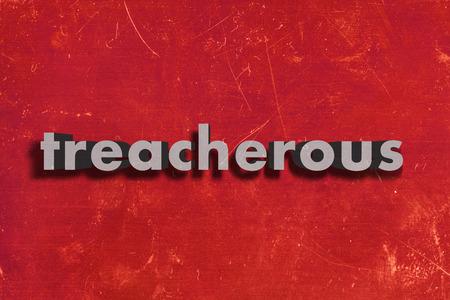 treacherous: gray word on red wall
