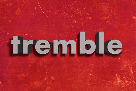 tremble: gray word on red wall