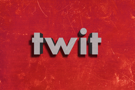 twit: gray word on red wall