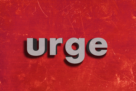 urge: gray word on red wall