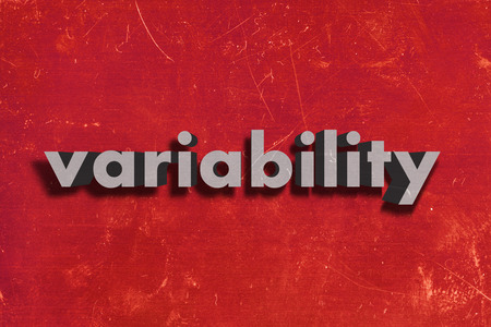 variability: gray word on red wall