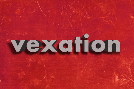 vexation: gray word on red wall