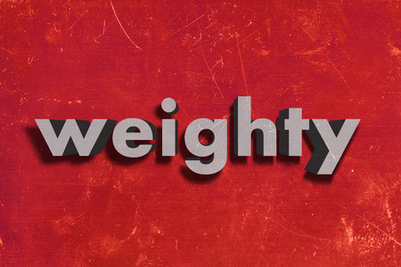 weighty: gray word on red wall