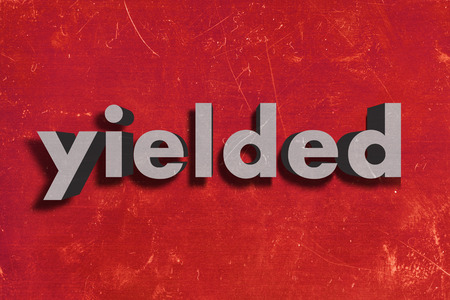 yielded: gray word on red wall