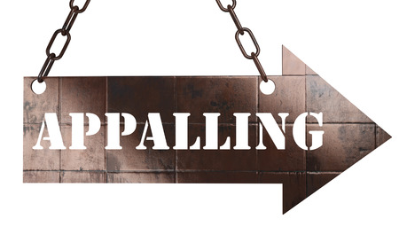 appalling: word on copper arrow Stock Photo