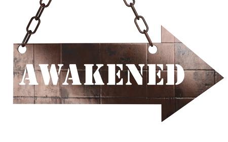 awakened: word on copper arrow Stock Photo