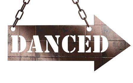 danced: word on copper arrow Stock Photo