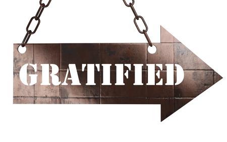gratified: word on copper arrow Stock Photo