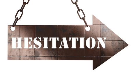 hesitation: word on copper arrow Stock Photo