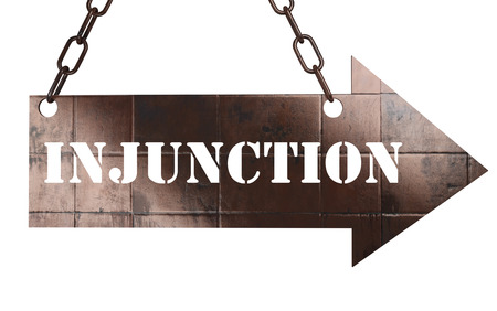 injunction: word on copper arrow Stock Photo