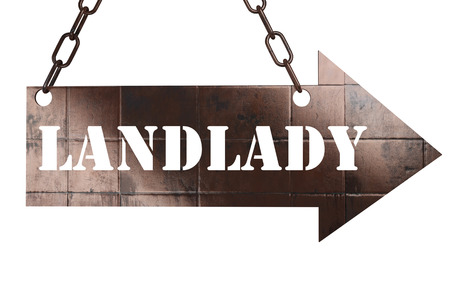 landlady: word on copper arrow Stock Photo