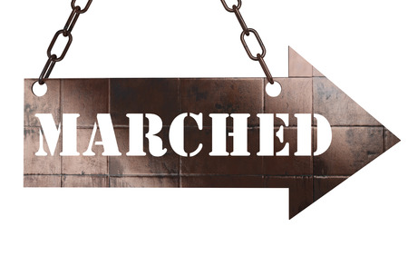 marched: word on copper arrow Stock Photo