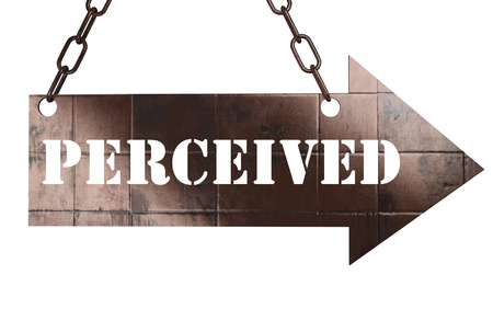 perceived: word on copper arrow Stock Photo