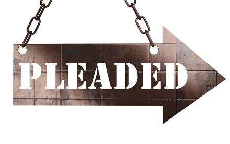 pleaded: word on copper arrow Stock Photo