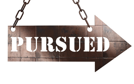 pursued: word on copper arrow Stock Photo