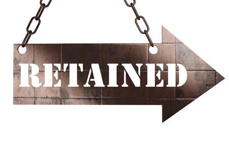 retained: palabra en la flecha de cobre