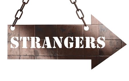 strangers: word on copper arrow Stock Photo