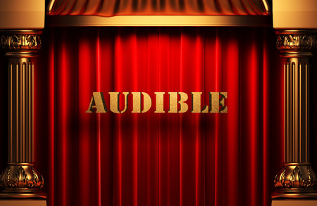 audible: golden word on red velvet curtain