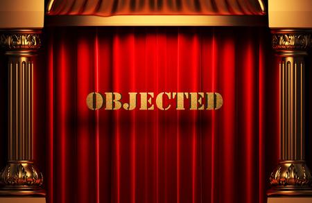 objected: golden objected word on red velvet curtain Stock Photo