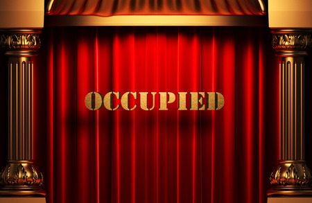 occupied: golden occupied word on red velvet curtain