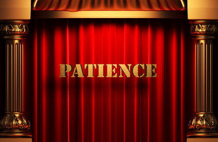 golden patience word on red velvet curtain