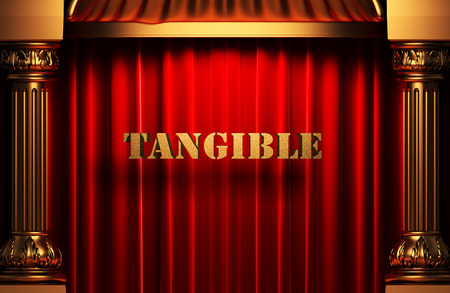 tangible: golden word on red velvet curtain