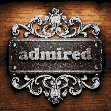 admired: iron admired word on wooden background