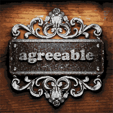 agreeable: iron agreeable word on wooden background