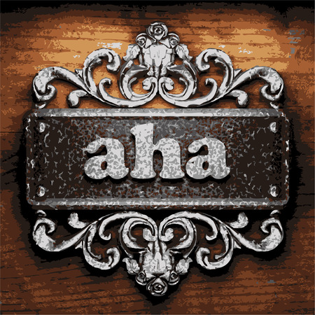 aha: iron aha word on wooden background