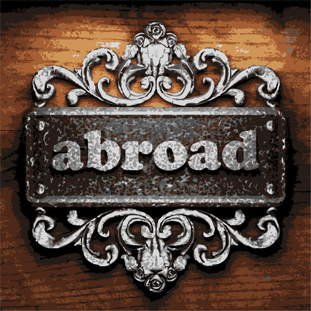 해외로: iron abroad word on wooden background