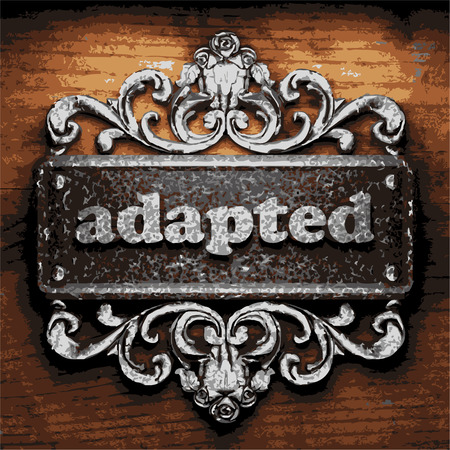 adapted: iron adapted word on wooden background