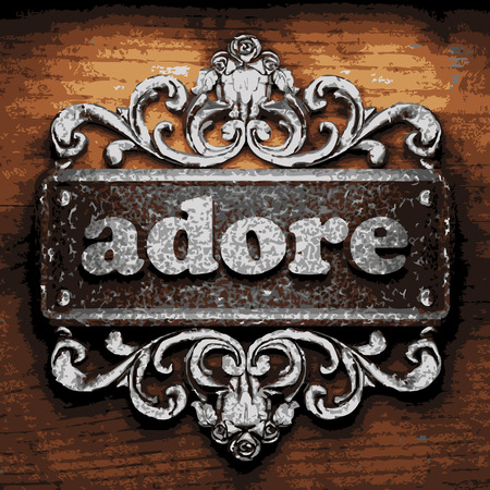 adore: iron adore word on wooden background