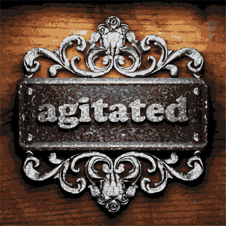 agitated: iron agitated word on wooden background
