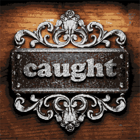 caught: vector iron word on wooden background