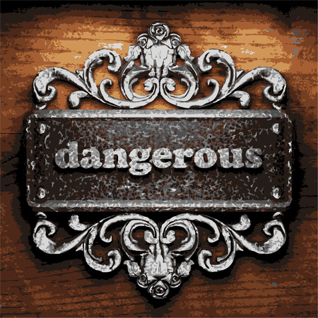 dangerous construction: vector iron word on wooden background