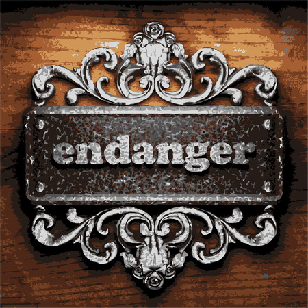 endanger: vector iron word on wooden background