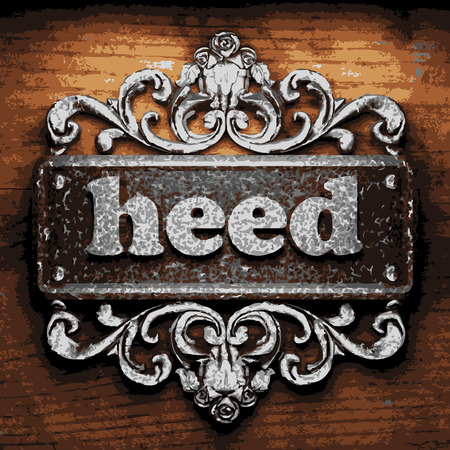 heed: vector iron word on wooden background