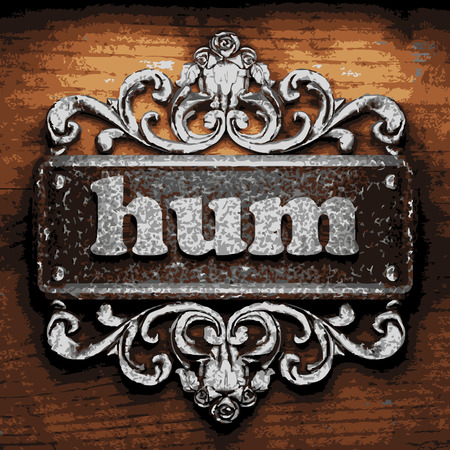 hum: vector iron word on wooden background