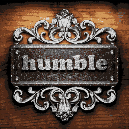 humble: vector iron word on wooden background