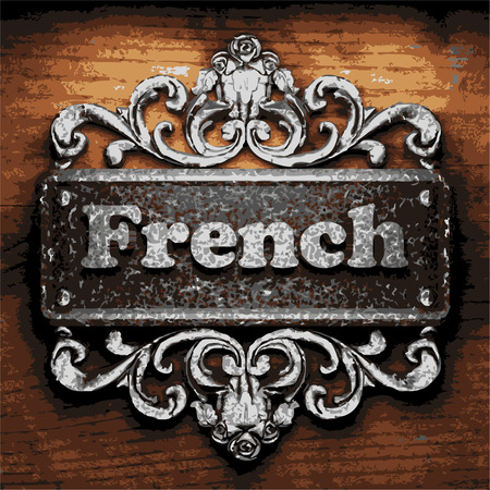 french countryside: iron word on wooden background